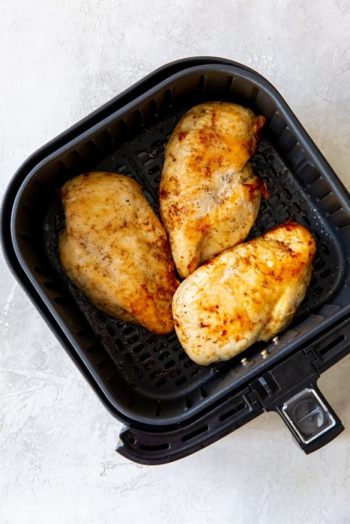 Title and Shown: The Best Air Fryer Chicken Breasts (on a white plate)