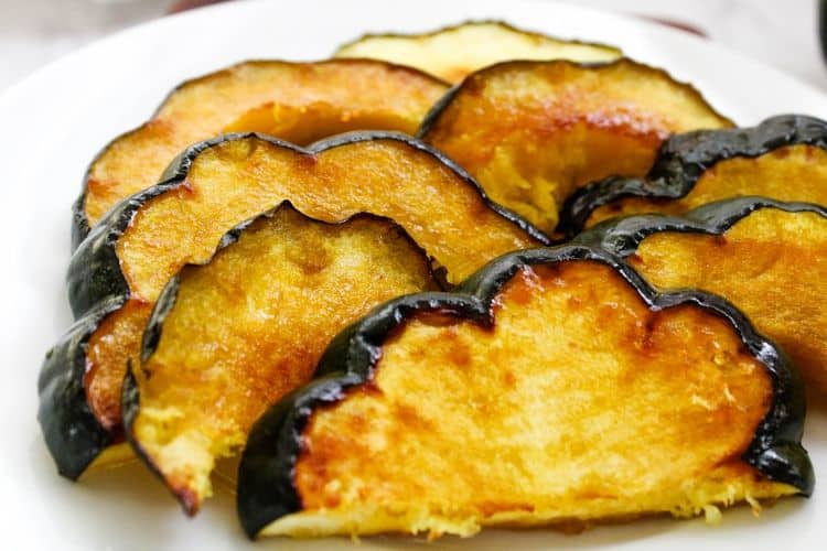 Closeup of Acorn Squash Slices on a white plate