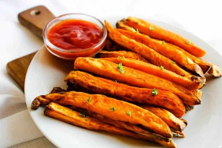 Sweet Potato Fries with Ketchup on a white plate
