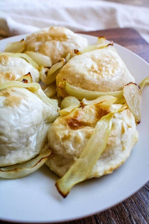 Air Fryer Pierogies with Onions on a white plate