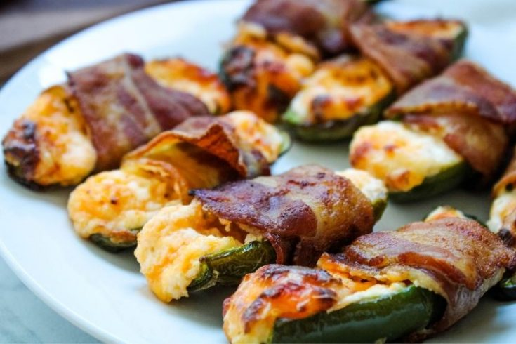 Bacon Wrapped Jalapeno Poppers on a white plate