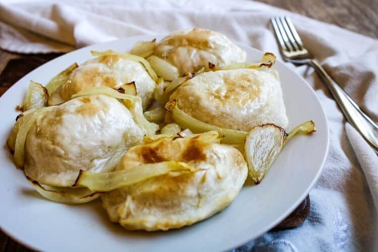 Air Fried Pierogies with onions on a white plate