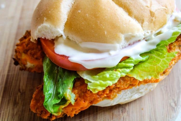Buffalo Chicken Sandwich on a wooden cutting board