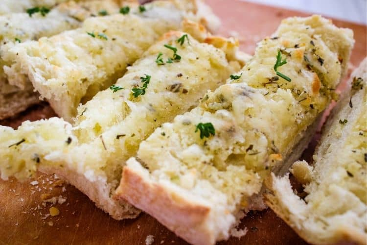 Closeup of Cheesy Garlic Bread cut into slices