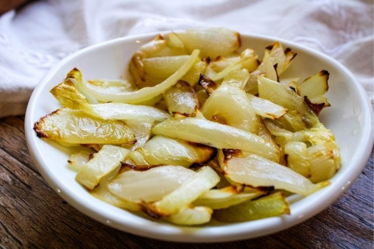Air Fryer Sauteed Onions in a shallow white bowl