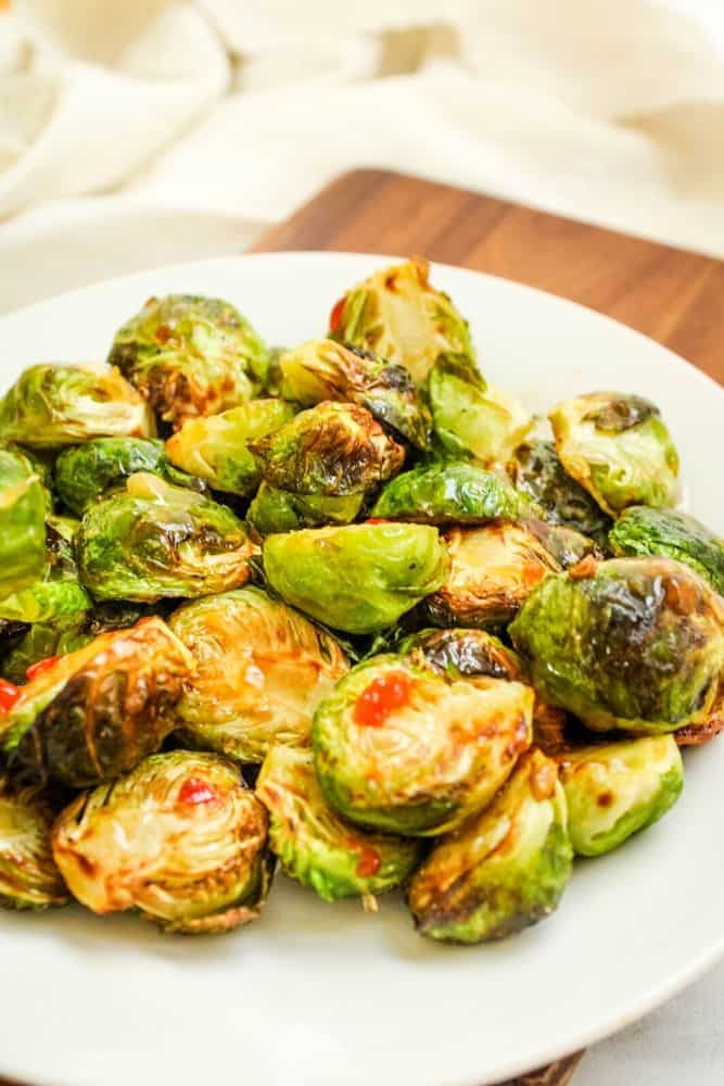 Sweet Chili Brussels Sprouts on white plate
