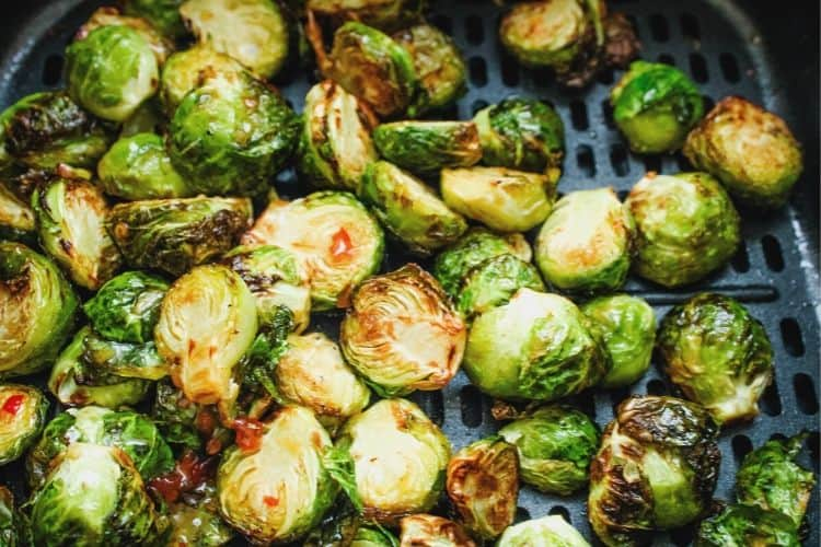 Sweet Chili on Brussels Sprouts inside air fryer