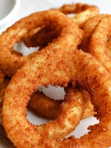 Air Fryer Onion Rings with Ketchup on a white plate
