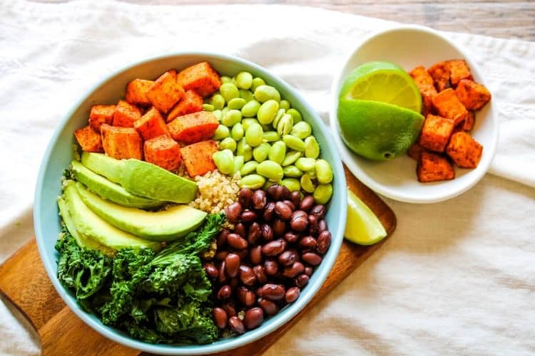 Sweet Potato Grain Bowl with a small bowl of Mexican sweet potatoes next to it with a lime