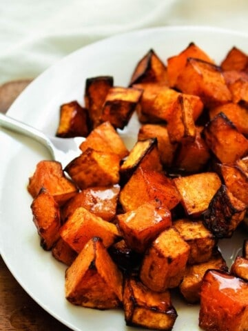 Air Fryer Butternut Squash on a white plate with fork in it