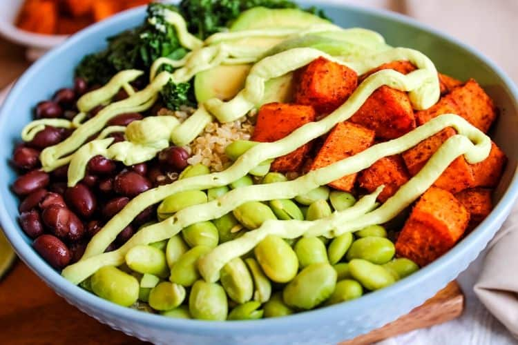 Grain Bowl with Avocado Sauce on top in a blue bowl