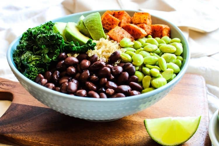 Buddha Bowl in a blue bowl with a lime wedge on the side