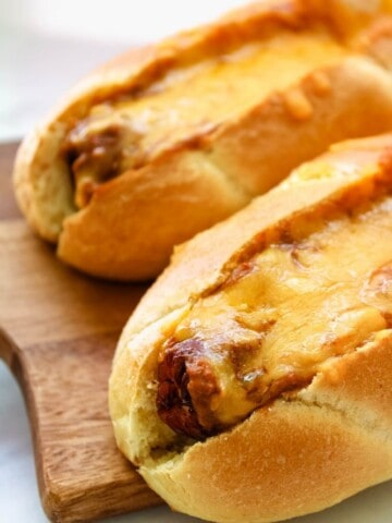 Chili Cheese Air Fryer Dogs on a cutting board