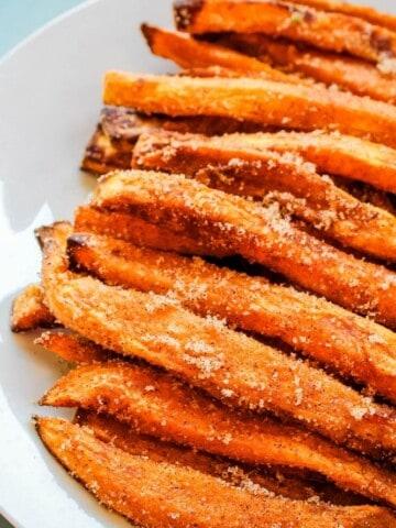 air fryer sweet potato dessert fries on a white plate