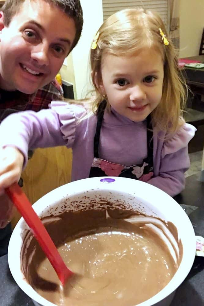 Dad and Toddler Baking and mixing a bowl