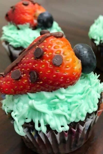 Strawberry Ladybug Cupcakes on a brown table
