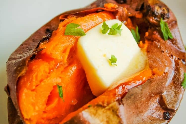 Air Fryer Sweet Potato cut in half with butter in the middle