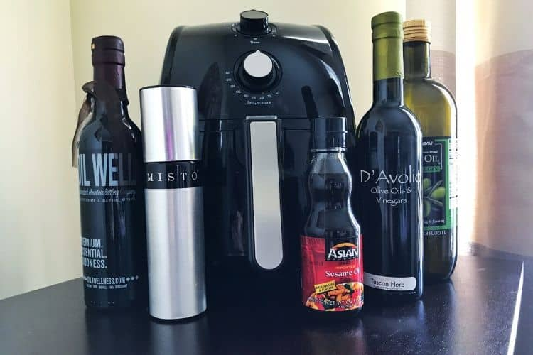 Oil bottles in front of an air fryer