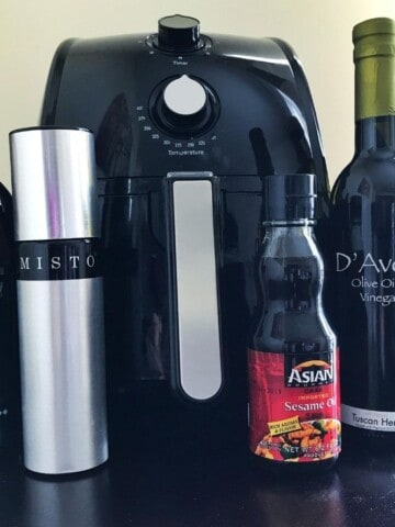 Air Fryer with oil bottles in front of it