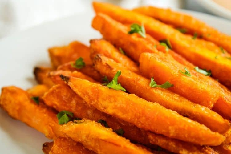 Sweet Potato Fries cooked from frozen on a white plate