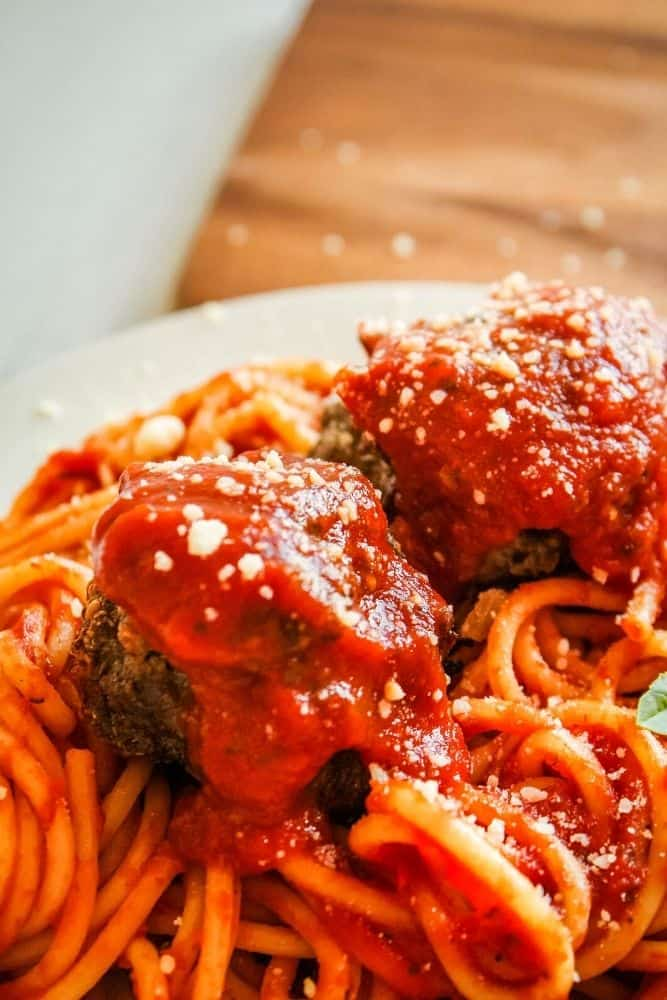 Meatballs and spaghetti covered in sauce.