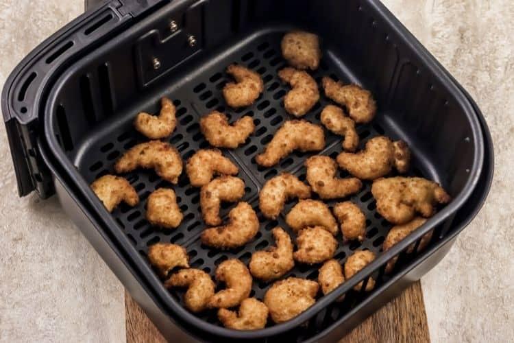 Cooked Popcorn Shrimp inside Air Fryer