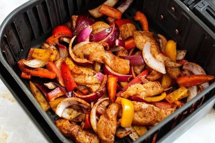 Raw chicken fajitas inside air fryer
