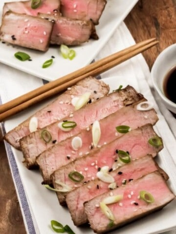 Air Fryer Tuna Steaks sliced on a rectangular plate with chopsticks