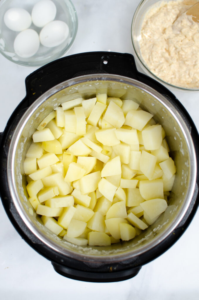 Potatoes chopped up into Instant Pot