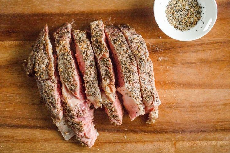 Air Fryer steak cut into slices on a cutting board