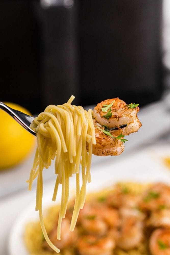 Air Fryer Shrimp on a fork with pasta swirled on it