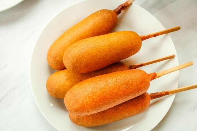 Air Fryer Corn Dogs on a white plate