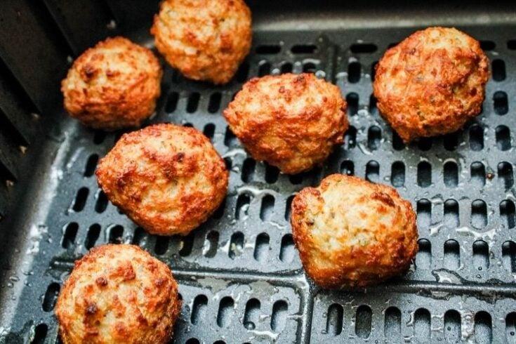 Cooked meatballs inside air fryer