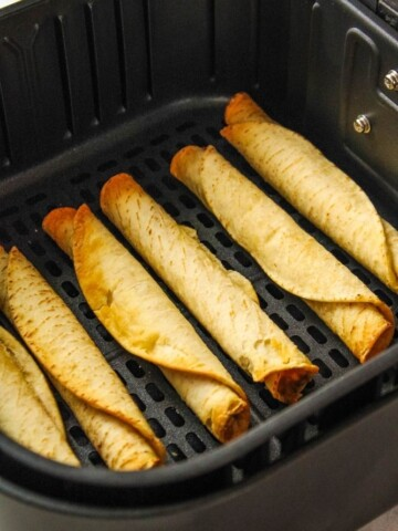 Cooked taquitos in an air fryer