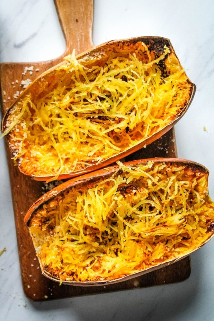 Air Fryer Spaghetti Squash cooked and cut into half with strands inside the halves