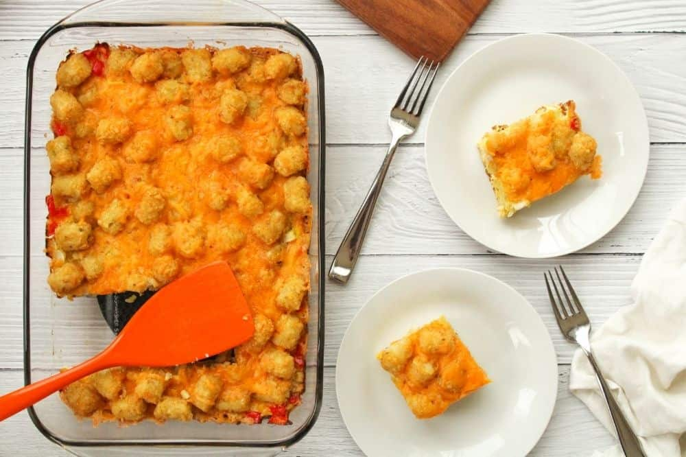 Tater Tot Casserole in 13x9 pan with slices cut out on white plates