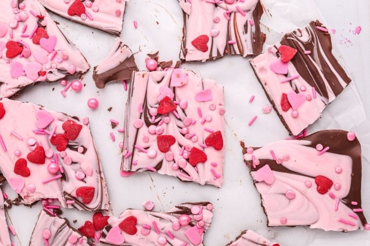 Valentine's Day Chocolate Bark broken into pieces on parchment paper