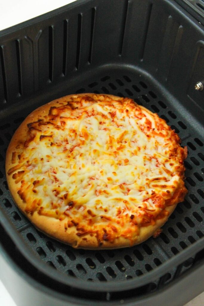 Cooked frozen pizza in air fryer