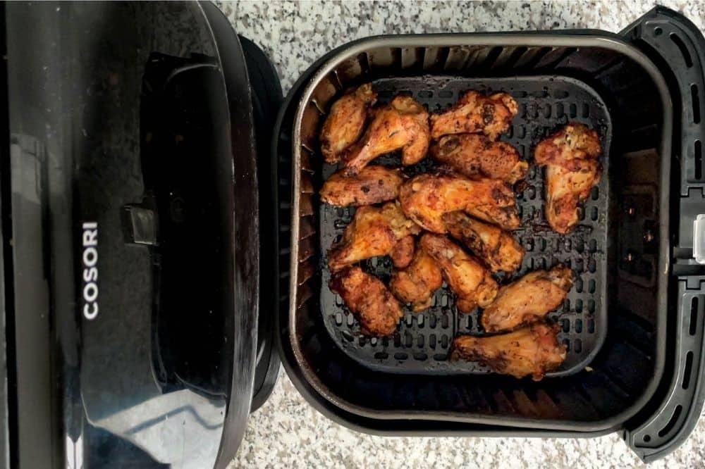 Cooked lemon pepper wings in air fryer basket