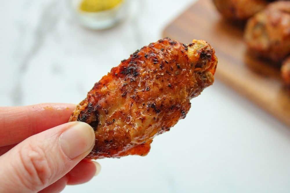 Air Fryer Chicken Wing in hand