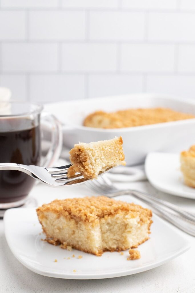 Bisquick Coffee Cake with bite on a fork held over the cake