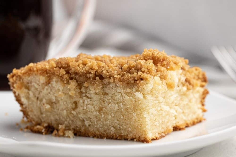 Closeup of a piece of the Bisquick Coffee Cake recipe on a white plate