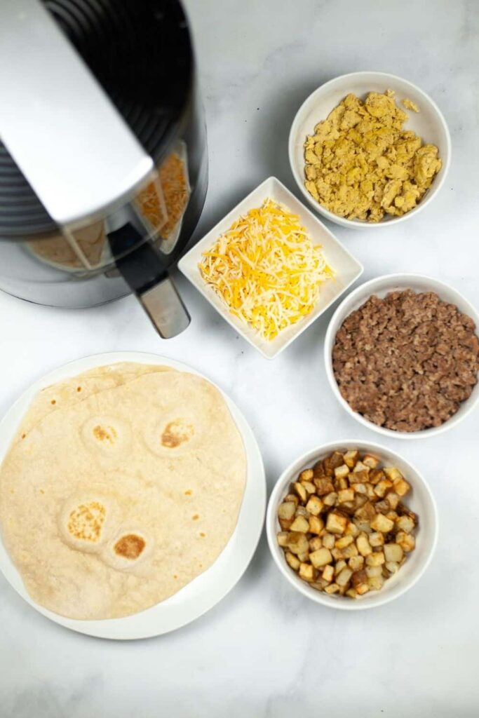 Overhead photo of each ingredient in recipe with the air fryer as well