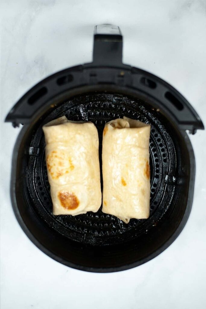 Breakfast Burrito inside the air fryer before cooking