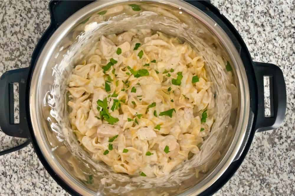 Finished Chicken Stroganoff in Instant Pot with parsley sprinkled on top