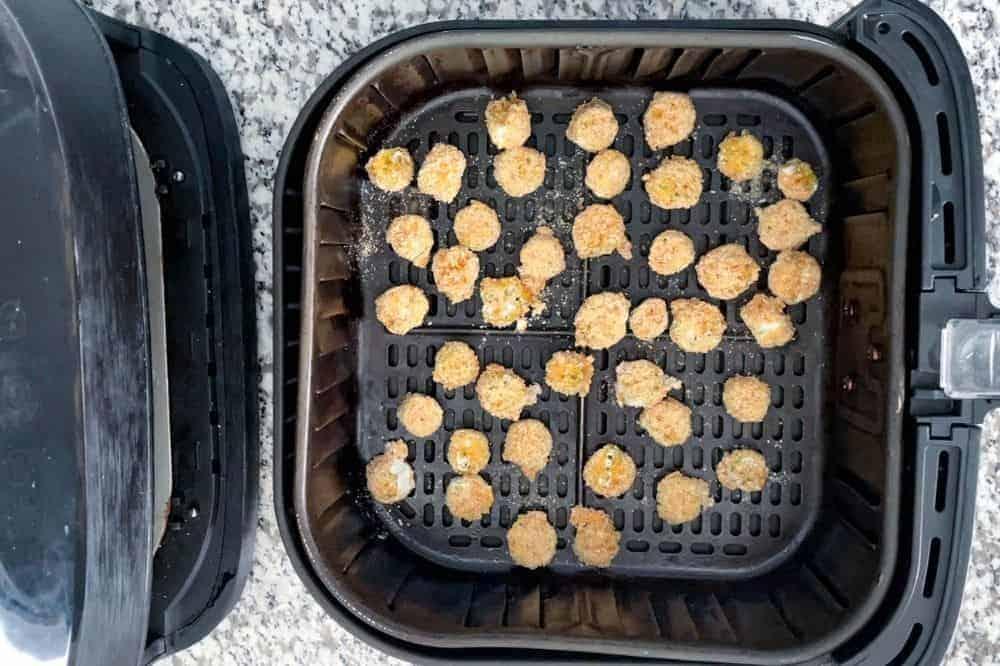 Uncooked breaded okra in air fryer
