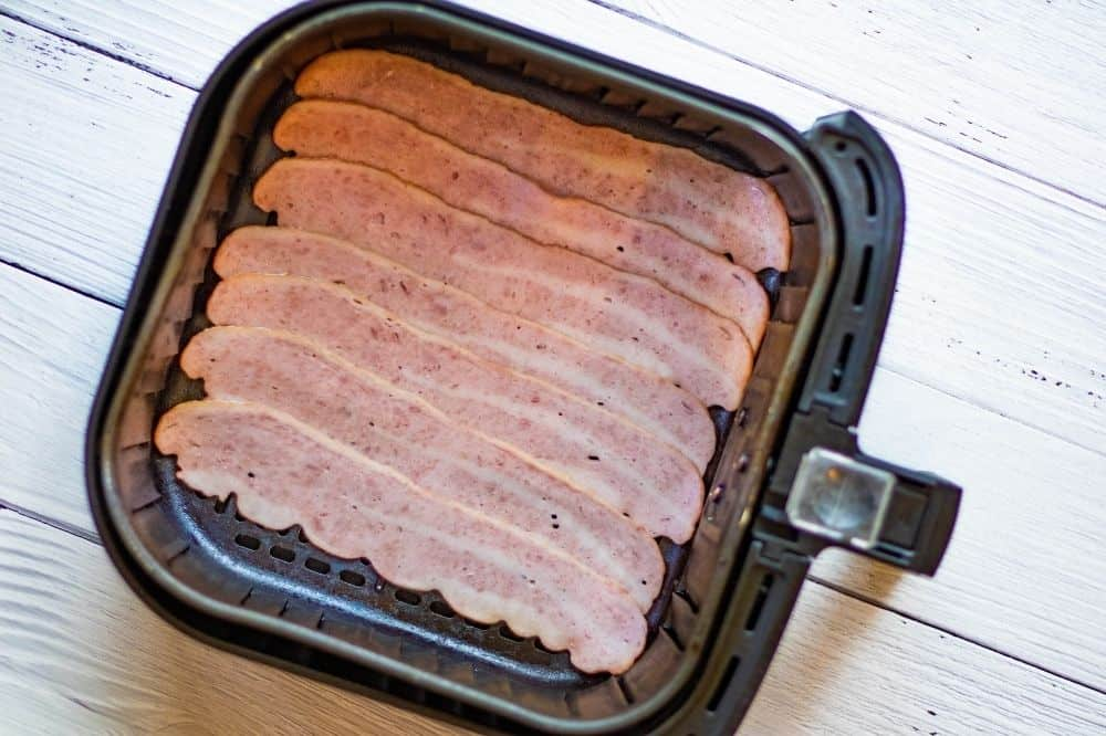 Raw turkey bacon in air fryer.