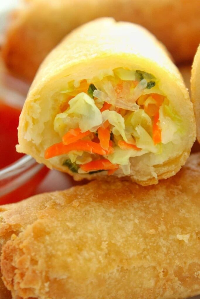 Very Closeup of frozen egg roll cut open to see the inside