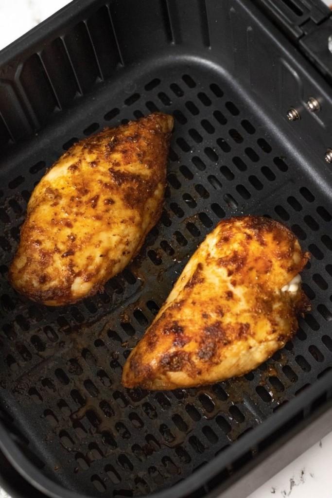 Cooked frozen chicken in air fryer overhead view