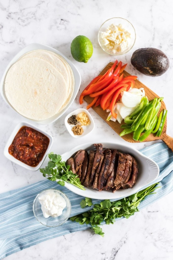 Overhead view of ingredients needed to make steak fajitas